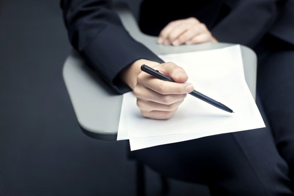 Close-up of business person with documents and pen
