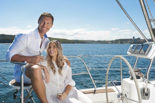 Couple in love sailing on a yacht drinking champagne