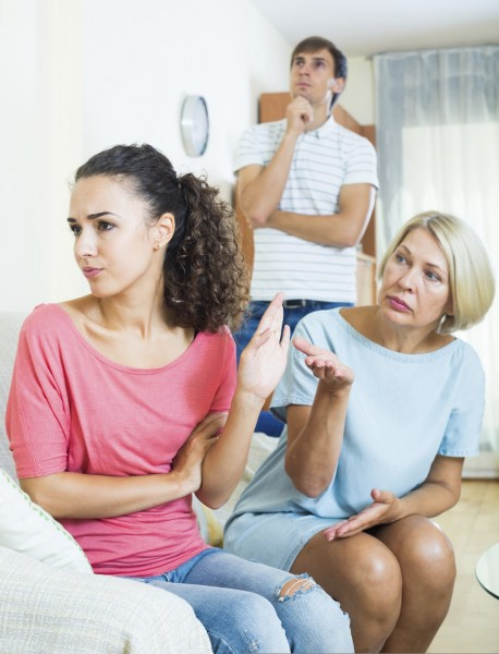 Adult girl having quarrel with husband and mother-in-law