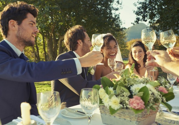 Shot of guests toasting the bride and groom at a wedding reception