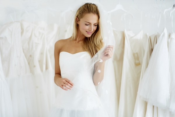 A young bride trying on her wedding dress - Copyspace