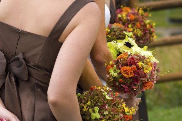 Bridesmaids and Fall Flower Bouquet at the Wedding Ceremony