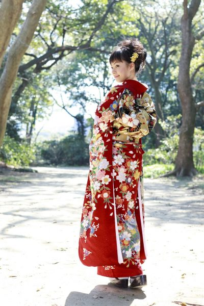 Woman wearing Japanese kimono in the forest.