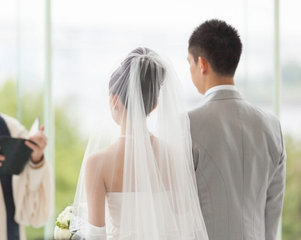 Man and woman getting married in wedding ceremony
