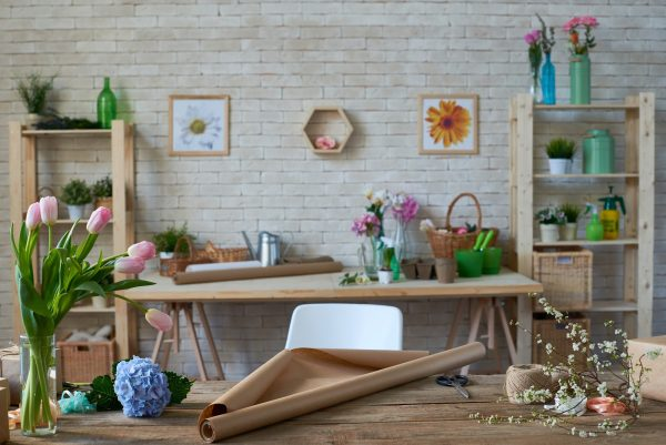 Cozy florist's workshop with various flowers