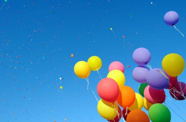 multicolored balloons and confetti in the city festival#9