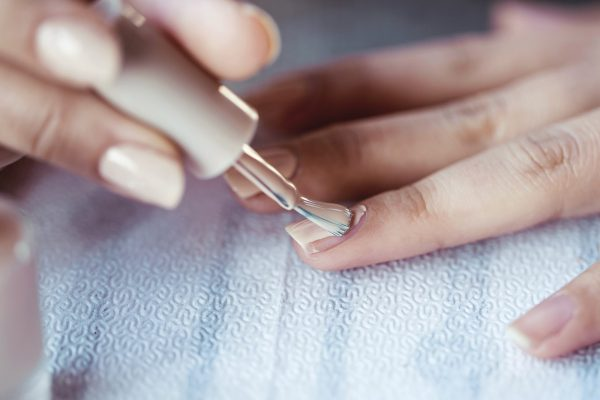 Beautiful manicured woman's nails with cream nail