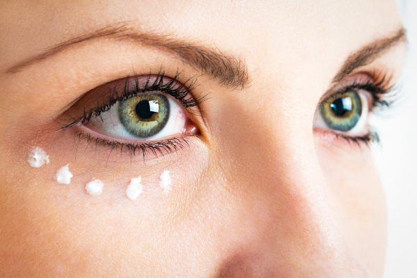 Caring for the skin around the eyes. Photo closeup.