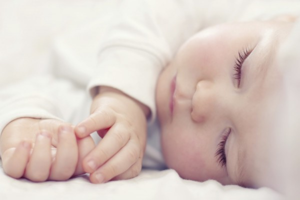 close-up portrait of a beautiful sleeping baby on white