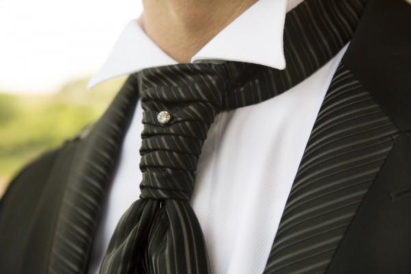 Groom in elegant black dress