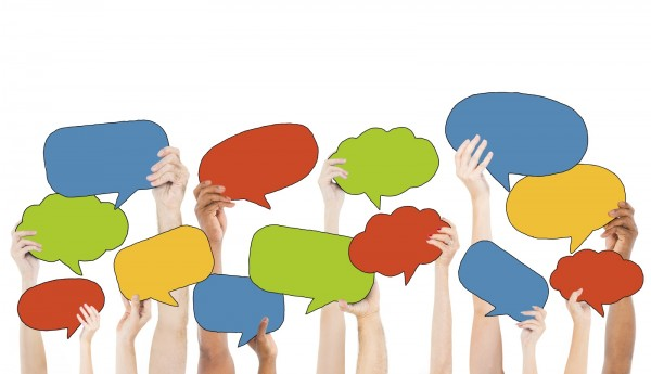 Multi-Ethnic Group of Hands Holding Speech Bubbles