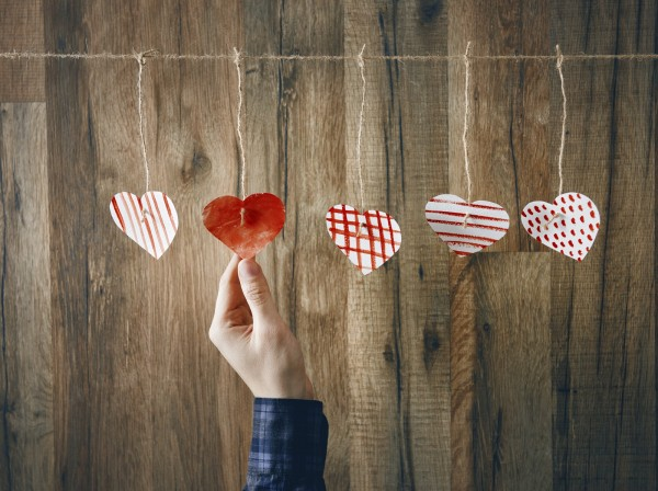 Paper hearts on wooden background. Love, Valentine Day concept.