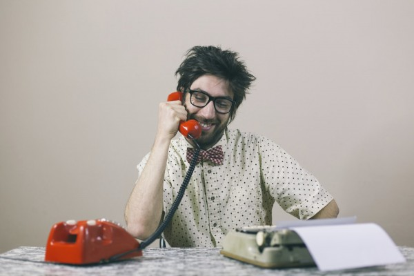 Nerd writer talking on phone