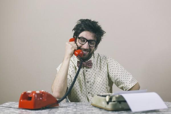 Nerd writer talking on phone