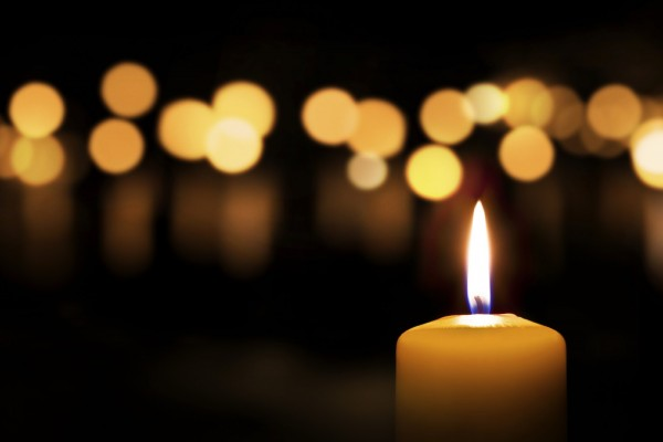 Three candles on dark background