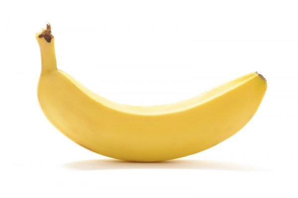 Yellow banana isolated on white background. With shadow.