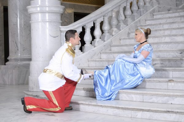 Cinderella and Prince Charming sitting on staircase.